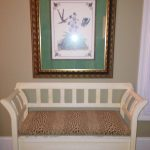 white-bench-with-upholstered-seat-and-large-framed-print