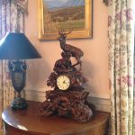 decorative-mantle-deer-clock-and-demilune-pair-of-lamps